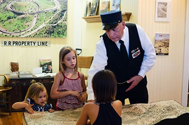 Man showing children trains